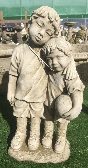Two little footballers stone ornament